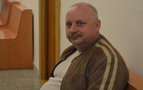 Jaroslav Papoušek včera u soudu.