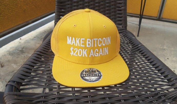 Některý merchandising s tematikou bitcoinu nabývá při sestupu z nových cenových rekordů ironické rysy.