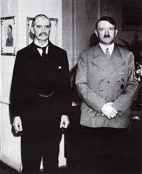 Adolf Hitler a Neville Chamberlain.