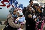 Němci letos odmítli přes 18 tisíc migrantů, domů je vozí i český Travel Service