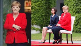 Merkelová si na hymnu opět sedla. Třesu se bránila i založenýma rukama