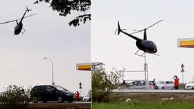 Polák s vrtulníkem přistál na čerpací stanici: Zákazníci se nestačili divit!
