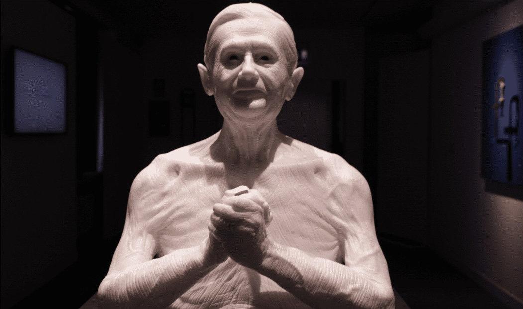 Papež Benedict. Socha byla původně oděna v tradičním hávu, nicméně po Benedictově abdikaci se k ní Jago vrátil, otesal roucho jako symbol návratu ke zbytku smrtelníků.