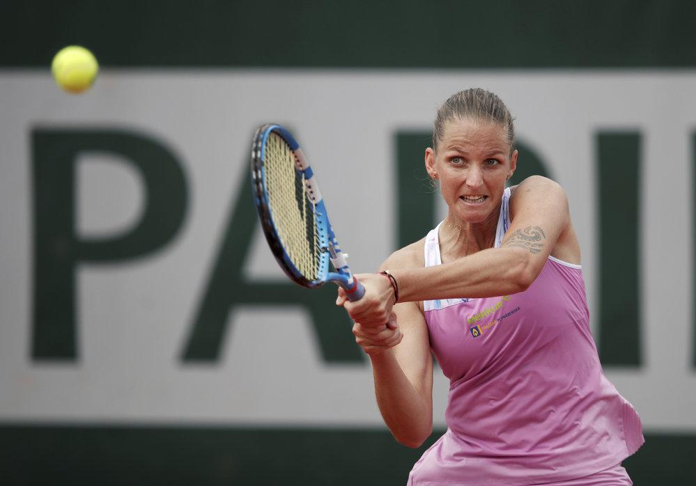 Karolína Plíšková v růžovém tenisovém dresu