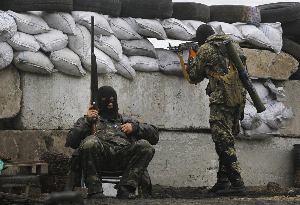Ozbrojenci na východě Ukrajiny (rok 2014).
