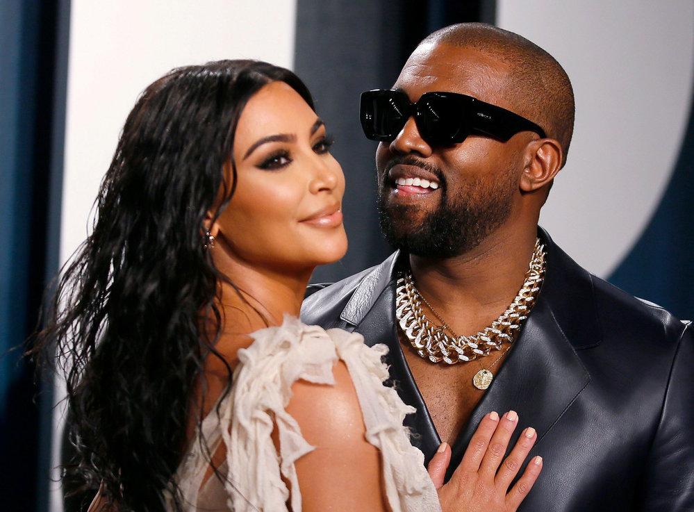 Americký rapper Kanye West s manželkou Kim Kardashianovou.